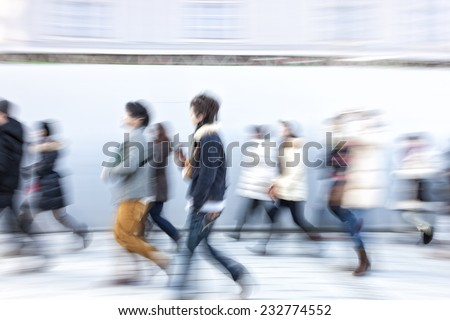 Japanese people walking in the city - stock photo