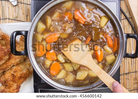 Japanese pork curry in the pot / cooking Japanese pork curry paste concept - stock photo