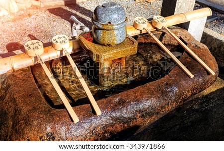 Japanese purification fountain in Fushimi Inari Shrine, Kyoto, Japan - stock photo