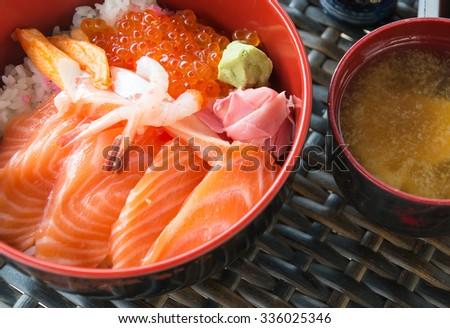 Japanese Rice with salmon sashimi on top - stock photo