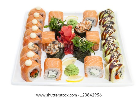 Japanese rolls in a restaurant with fish and vegetables - stock photo