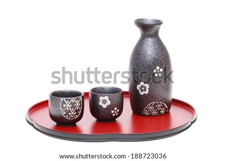 japanese sake bottle and cup on tray, isolated on white background  - stock photo