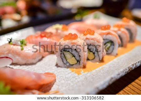 Japanese salmon dishes with salmon rolls , salmon sushi and salmon yome - stock photo