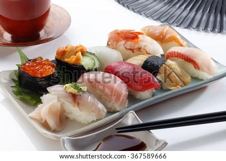 Japanese seafood sushi /many tasty fresh japanese sushi with tuna, caviar and shrimp  - stock photo