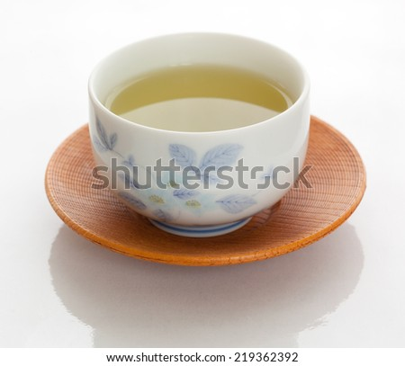 Japanese simmered green tea in a ceramic cup - stock photo