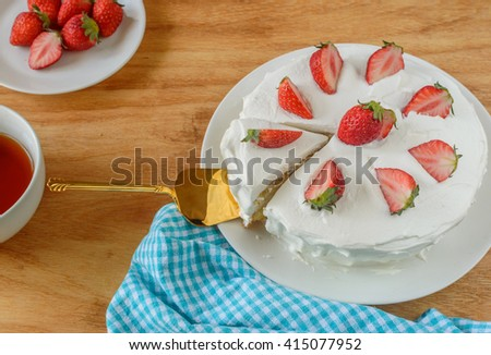 Japanese strawberry shortcake, a layered sponge cake with a strawberry and whipped cream filling, and whipped cream frosting - stock photo
