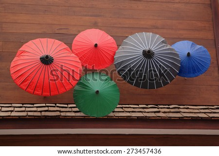 Japanese Style Colorful Umbrellas decorated on the house wall - stock photo