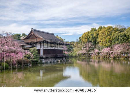 Japanese-style garden with cherry blossom in Heian Shrine - stock photo