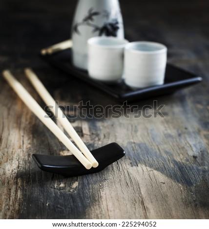 Japanese style table set and sake. - stock photo