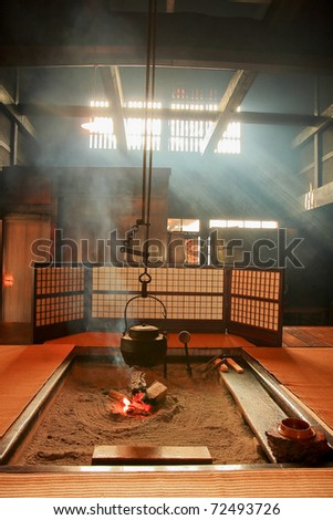 japanese-style Teapot and amazing light ray in japan living room - stock photo