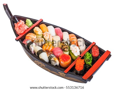 Japanese sushi fish and seafood on a  on a black plate. Isolated on white background
