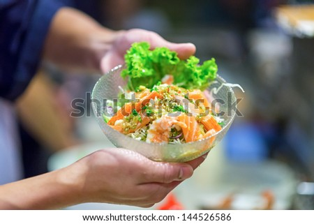 Japanese sushi in chef hands - stock photo