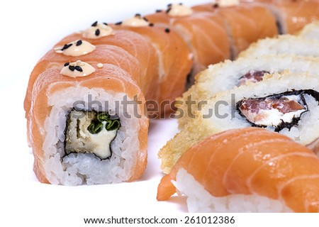 Japanese sushi on a white background closeup - stock photo