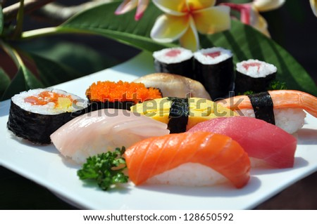 Japanese sushi on a white plate. - stock photo