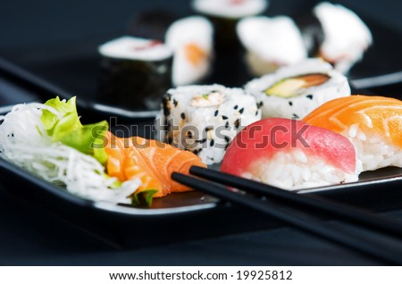 Japanese sushi on black plate