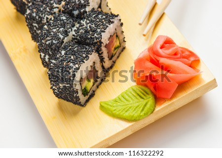 Japanese sushi on the board - stock photo