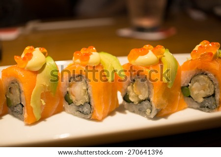 Japanese sushi rolls : California Maki with salmon and avocado