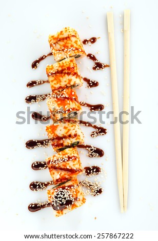 japanese sushi rolls with sauce and  Chopsticks on a white background