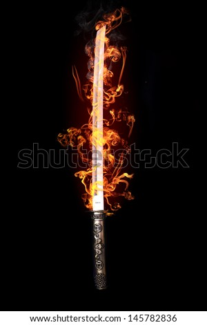 Japanese sword in flames - stock photo