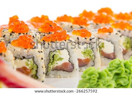 Japanese tasty sushi set on a white plate - stock photo