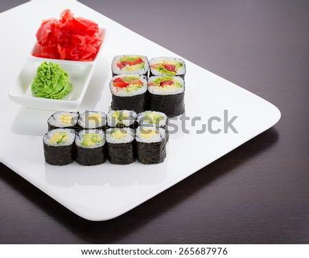 Japanese tasty sushi set on white plate - stock photo