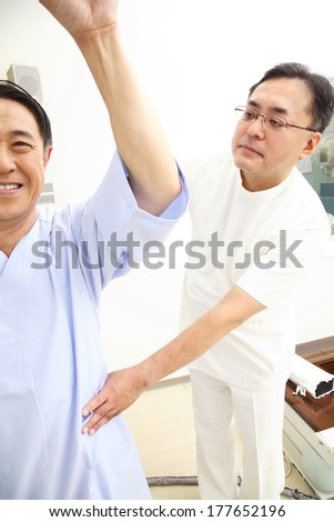 Japanese Technician explaining X-ray to patient