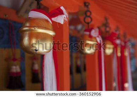 Japanese temple bells in Fushimi Inari Taisha Shrine, Kyoto, Japan - stock photo