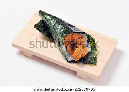 Japanese traditional cuisine- Sushi temaki on wooden plate isolated over white background-4 - stock photo