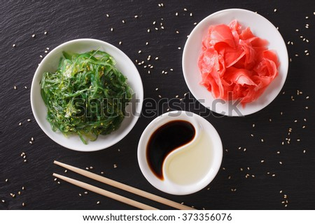Japanese wakame seaweed salad with sesame seeds on a table. Horizontal top view - stock photo