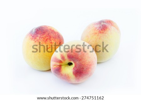 Japanese white peaches on white background