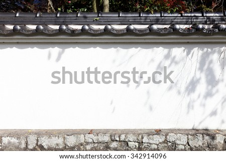 japanese white wall, castle or temple wall - stock photo