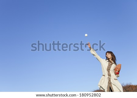 Japanese woman catching a ball