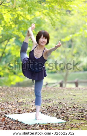 """Japanese Woman Doing YOGA """"lord of the dance pose"""" - stock photo"""
