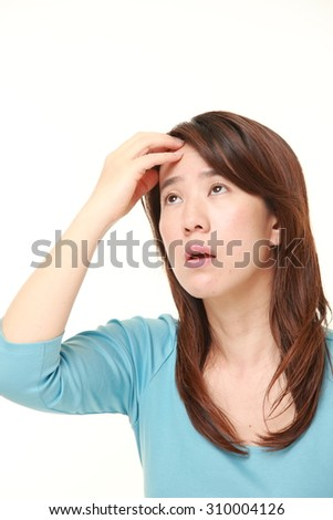 Japanese woman has lost her memory - stock photo