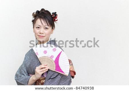 Japanese woman in a kimono - stock photo
