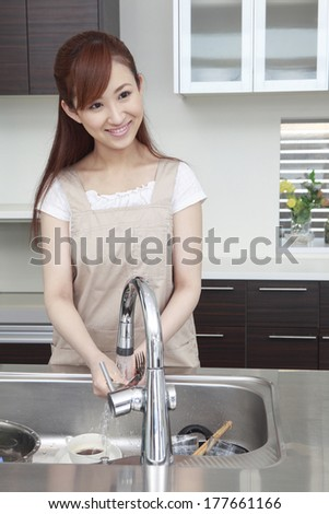 Japanese woman washing the dishes