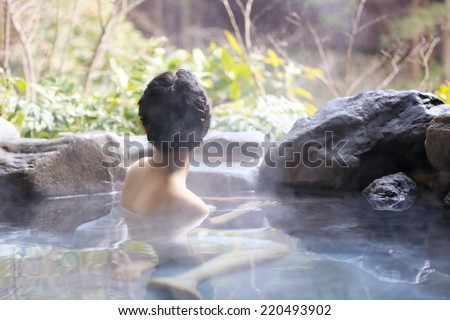 Japanese women relaxing in the hot springs. - stock photo