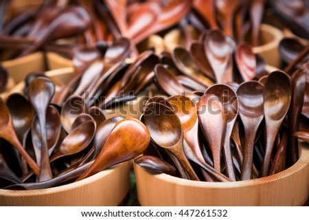 Japanese wooden spoons for sale at a market. A variety of styles in hardwoods with warm tones.  - stock photo