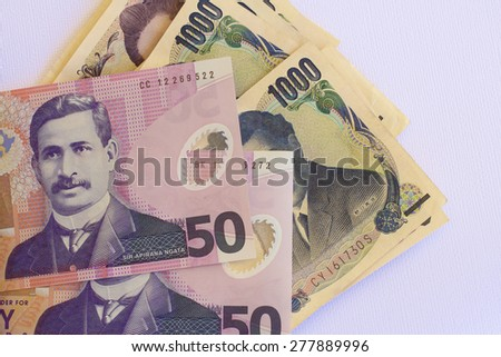 Japanese Yen and NZ Dollar Notes - stock photo