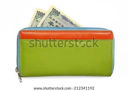 japanese yen banknotes in colorful leather wallet - stock photo