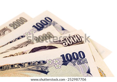 Japanese Yen : several different Japanese Yen currency bills isolated