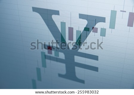 Japanese yen sign & stock chart on PC screen. Financial concept. - stock photo