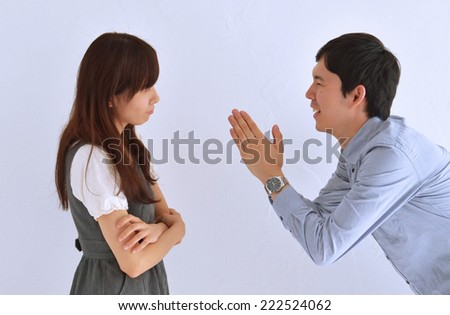 Japanese  young woman refusing apologies from her man. - stock photo