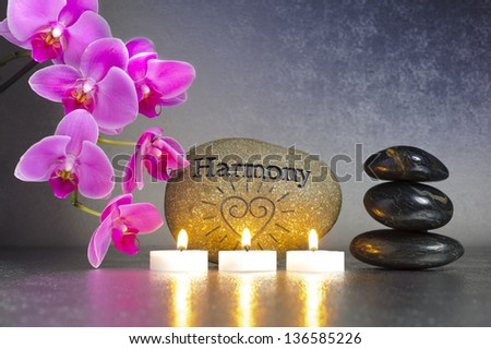 Japanese zen garden with candle lights and stone of harmony - stock photo
