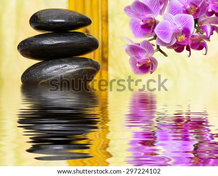 Japanese zen garden with stacked stones and mirroring in water - stock photo