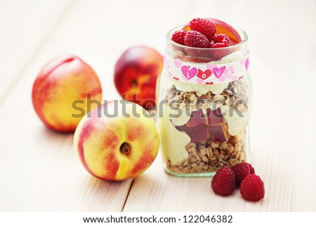 jar full of yogurt with cereals and fruits - diet and breakfast - stock photo
