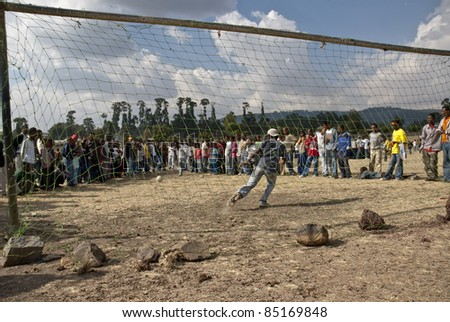 JAR MADA, ADDIS ABABA - JAN 18: Boys playing football during the Timket festival.  January 18, 2009 in Jar Mada, Addis Ababa, Ethiopia - stock photo