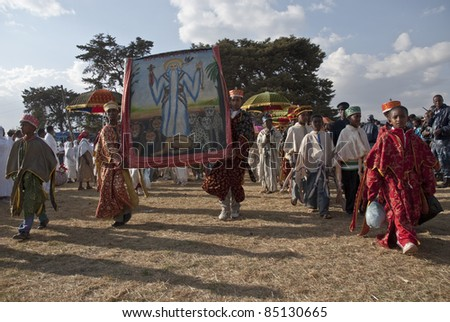 JAR MADA, ADDIS ABABA -  JAN 18:  Christian Orthodox devotees carry religious pictures at the Timket Festival. January 18, 2009 in Jar Mada, Addis Ababa, Ethiopia - stock photo
