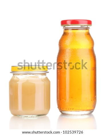 Jar of baby puree and juice isolated on white