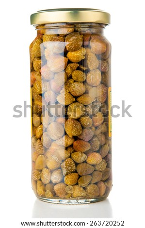 Jar of capers on white background - stock photo